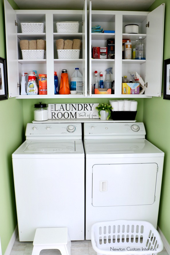 organizing a small laundry room with cabinet shelves storage newton